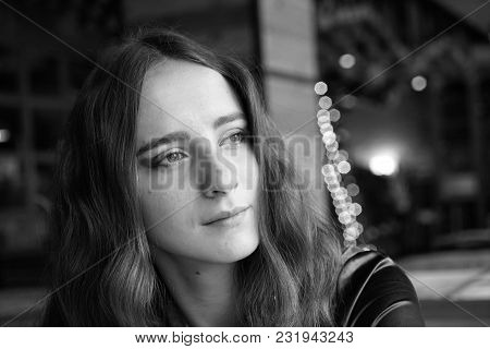 Lonely Girl Is Sitting In The Cafe. She Has Big Brown Eyes And Nice Brown Long Hair. Wearing A Brown