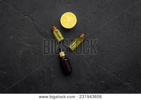 Organic Cosmetic With Lemon For Homemade Spa With Oil And Fresh Fruit On Black Background Top View M