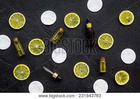 Homemade Spa With Lemon Oil In Natural Cosmetic Set On Black Desk Background Top View Space For Text