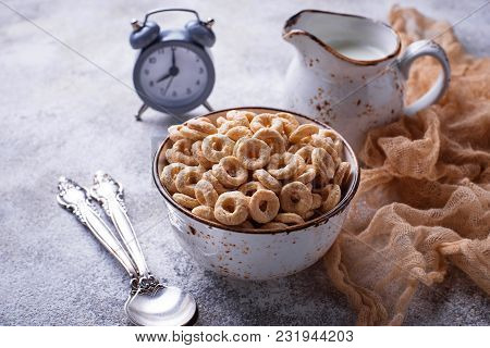 Sweet Cereal Loops In Bowl. Corn Flakes For Breakfast. Selective Focus