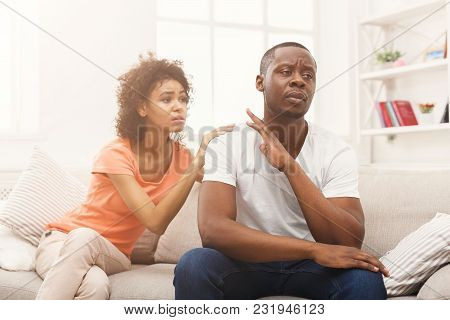 Young African-american Couple Making Peace After Quarreling At Home, Man Still Feeling Offended. Fam