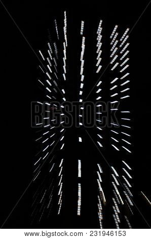 Zoom effect of dotted abstract light on black background. Futuristic wall of light streaks.
