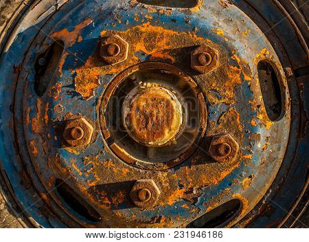 Close up of corroded and rusty metal wheel of the vehicle.
