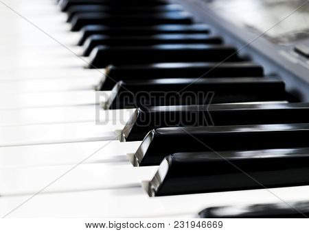Side View Of Piano Keys. Close-up Of Piano Keys. Close Frontal View. Piano Keyboard With Selective F