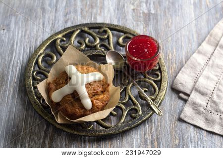 Easter Cross Muffins With Raisins, Cranberries And Raspberry Jam On A Wooden Table, Top View
