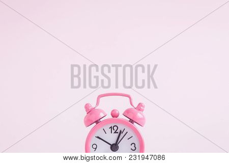 Alarm Clock On Pastel Pink Background. Space For Copy. Minimal Concept.