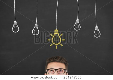 Thinking Human With Idea Bulb In Bubble On Chalkboard Background