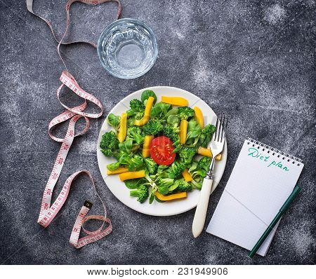 Healthy Salad, Clean Water And Measuring Tape.  Weigh Loss Concept