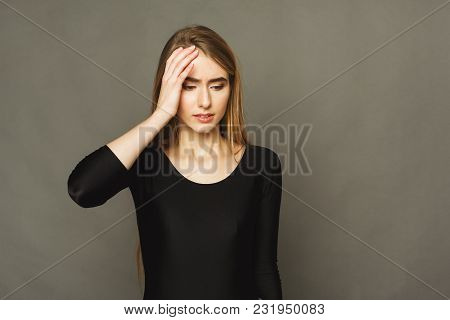 Portrait Of Young Desperate Woman Having Headache. Attractive Girl With Migraine Touching Her Head,