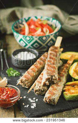 Traditional Homemade Grilled Turkish Adana Urfa Kebab, Minced Meat Kebab, On Slate Plate With Tomato
