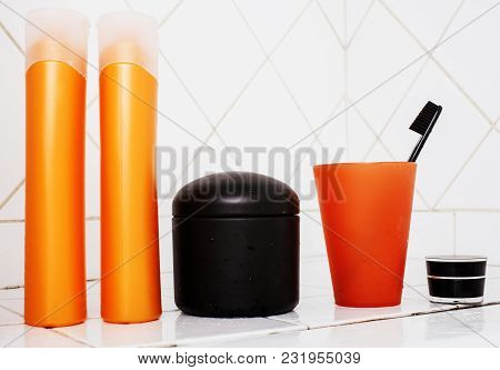 Usual Stuff In Bathroom, Shampoo, Accessories, Black Stylish Toothbrush, Casual Normal Real Backgrou