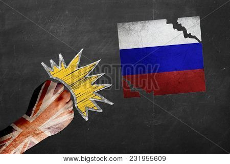 Fist With Russian Flag Beating And Tearing Us Flag. United Kingdom Vs. Russia. Difficult Political A