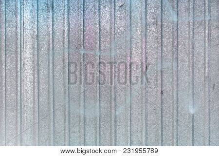Wall Of Sheet Metal. Beautiful Blank Background With Color Overflows. Texture Of Corrugated Metal.