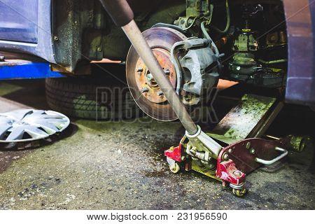 Complex Car Service Repair Inside Garage