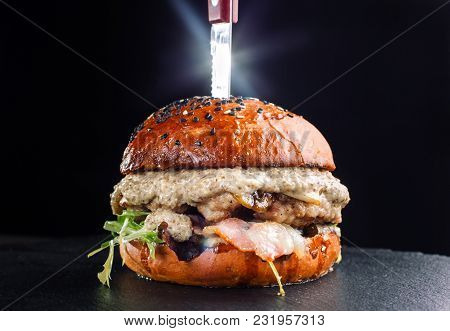 Close-up Of Delicious Fresh Home Made Burger With Mushrooms On A Black Slate On A Dark Background. B