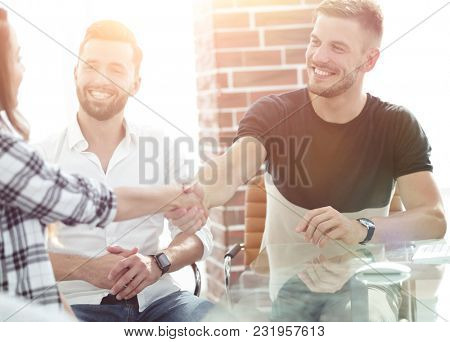 handshake of young employees