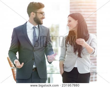 employees of the company discuss working issues standing in the