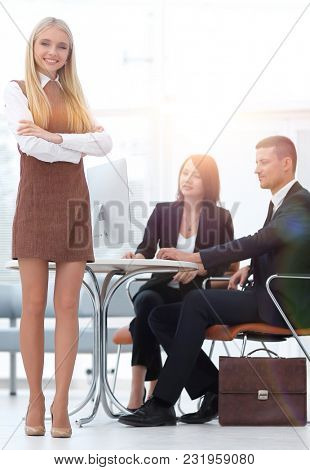 portrait of a girl attendant standing in the lobby of the Bank . concept of career.
