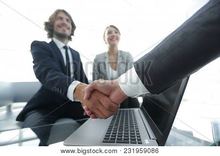 Two confidence businessman shaking hands close-up