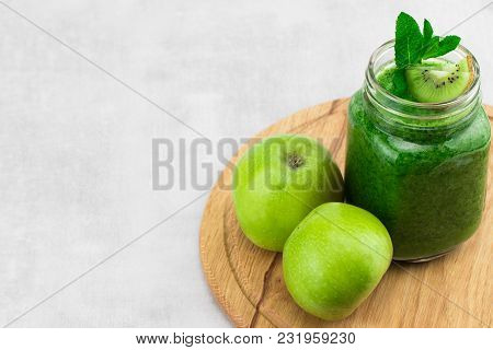 Healthy Green Smoothie With Spinach In A Jar Mug With Ingredients On Wooden Background With Copy Spa