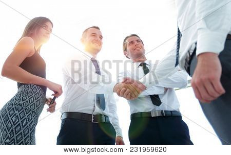 bottom view.handshake business colleagues.