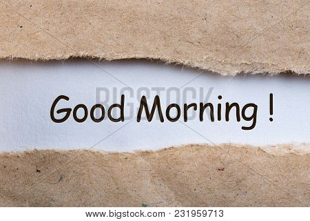 Piece Of Paper With Text Good Morning In Torn Envelope.