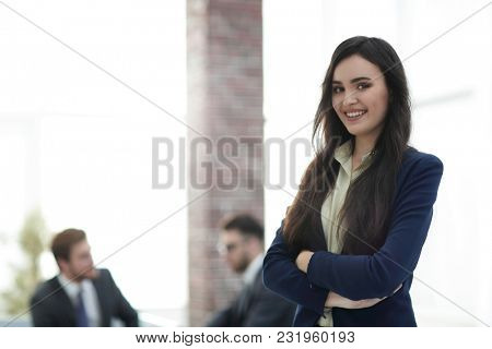 Face of beautiful woman on the background of business people.