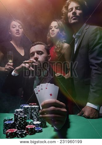 Man with cigar placing bet at roulette