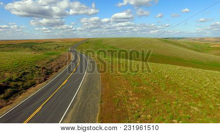 This Curvy Road Cuts Through Uncultivated Land In Eastern Washington Western United States