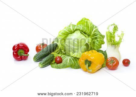 Green Cabbage. Yellow Pepper. Red Tomatoes And Cucumbers On A White Background. Composition From Dif