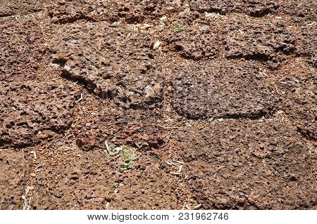Background Textured Of Red Laterite Brick Stones Floor. Laterite Is A Soil And Rock Type Used As Bui