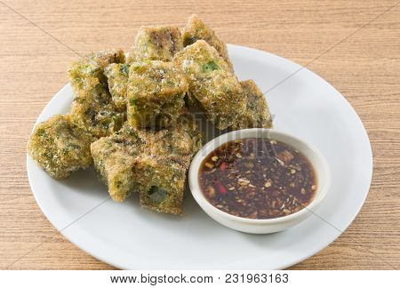 Plate Of Fried Chinese Pancake Or Fried Steamed Dumpling Made Of Garlic Chives, Rice Flour And Tapio