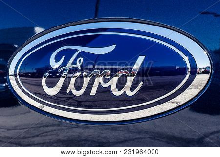 Fishers - Circa March 2018: Ford Oval tailgate logo on an F150 pickup truck. Ford sells products under the Lincoln and Motorcraft brands IX