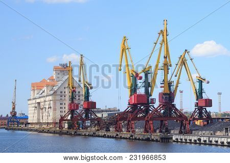 Heavy Harbour Jib Cranes In The Kaliningrad Sea Fishing Port.