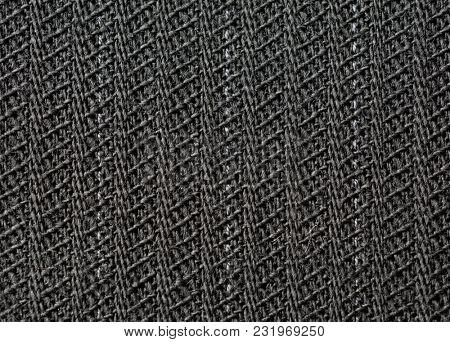 Black or dark grey pinstripe or chalk stripes suit fabric, 100% wool, High magnification macro.