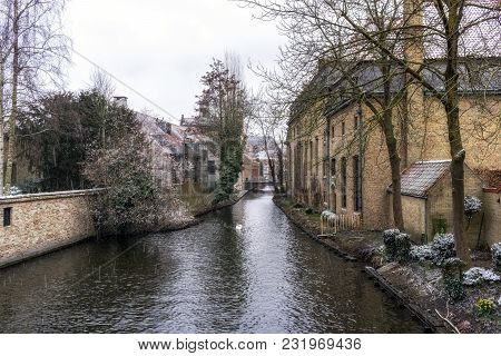 Snowing In Bruges Canal