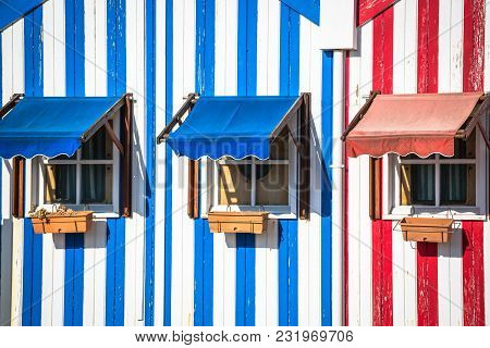 Colorful Striped Fishermen's Houses In Blue And Red, Costa Nova, Aveiro, Portugal