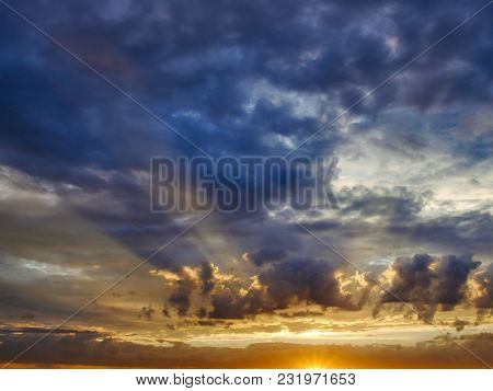 Impressive sky with sun rays seep through clouds during sunrise