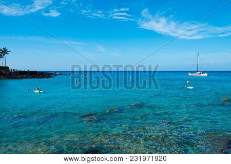 Mauna Lani Bay, Hawaii - January 5, 2018: Stand Up Paddleboards And Snorklers Enjoy The Warm, Blue W