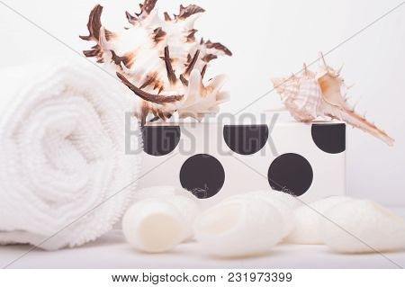 Set Of Skin Care With Silk Cocoon On A White Wood Background. Beauty Salon And Spa Concept.