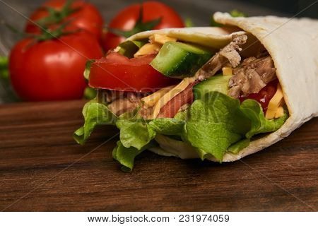 Burrito With Grilled Chicken And Vegetables Lettuce, Fresh Tomatoes, Cucumber, Onion And Cheese Roll