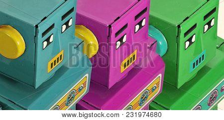 three robots  colorful looking on  macro image