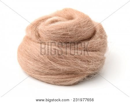 Hank of beige wool yarn isolated on white