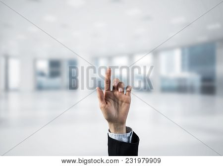 Close Of Businesswoman Hand Touching Screen With Finger And Office At Background