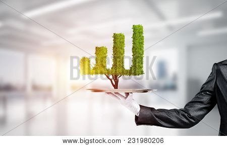 Hand Of Waitress Presenting Growing Graph On Tray.