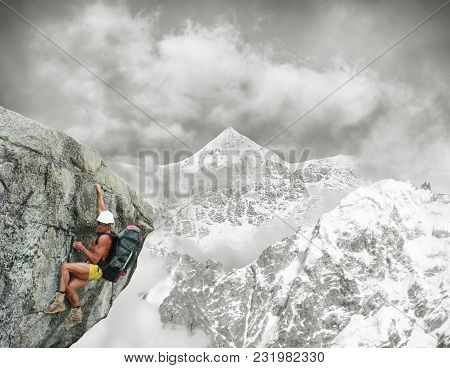 The Climber Climbs The Rock With A Large Backpack. Naked Athletic Folded Body With Tense Muscles. Hi