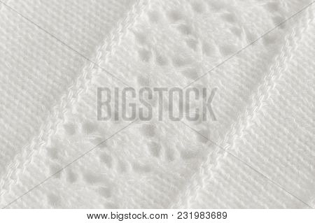 White Knitted Fabric With An Openwork Pattern, Handmade. Knitting On Knitting Needles Is A Hobby. Ba