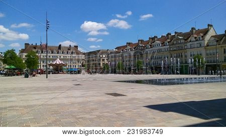 Empty Square With European Buildings, A Fountain, Sunny Day And Blue Sky.