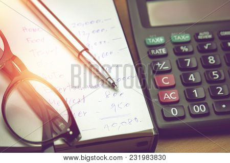 Pen And Eyeglasses On Household Account Paper, Personal Expenses Monthly, Home Budget With Calculato