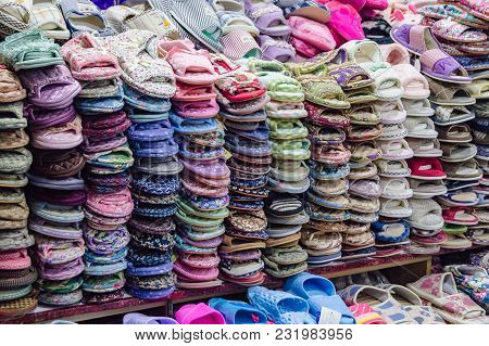 Yanjixi, Jilin, China - March 9, 2018: Slippers And Sandals Are Shown Sold Are Laid Out And Stacked